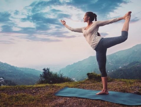 lady doing yoga on the mountain