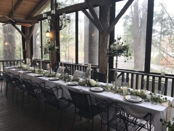 table set with flowers on deck